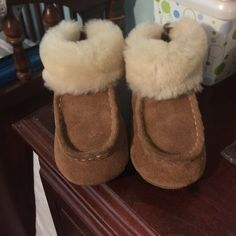 Baby Ugg boots. Baby Ugg boots. Worn a couple times, didn't actually walk in them. Amazing. UGG Shoes