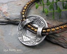 """Lisa Barth Metal Clay-- I like how the """"bail"""" lets the strands align."""