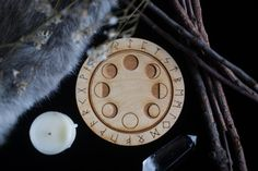 Super cool moon phase altar tile with runes.  Etsy https://www.etsy.com/nl/listing/202238307/unusual-optical-moon-phase-rune-altar
