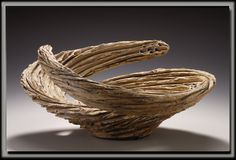 """Anne Goldman Ceramics, """"Whirlpool"""" 21 inches wide, stoneware, thrown then shaped, then slipped, carved and pierced.  """"As rip tides run parallel to each other, small whirlpools often occur."""""""