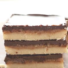 Dangerously delicious six ingredient, three layer chocolate and caramel Vegan and Paleo Millionaires Shortbread #GlutenFree #Paleo #Vegan #Pegan #Millionaires
