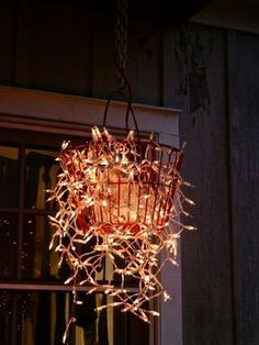The 86 best traditional christmas lights images on pinterest diy outdoor chandelier with string of white xmas lights and a wire basket aloadofball Images
