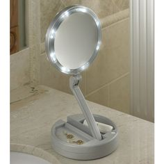 The Foldaway Lighted Vanity Mirror.