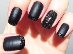 Black matte nails with silver glitter gloss french tips.