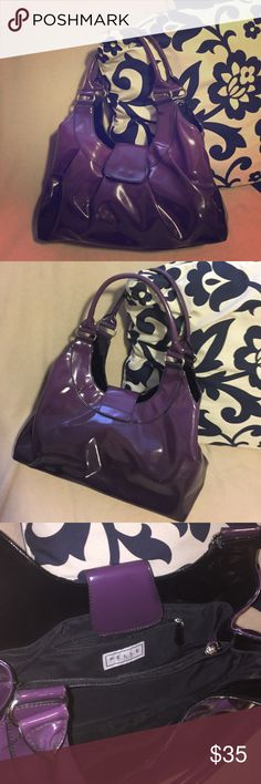 🎊 SALE 🎀 Ombré Purple PELLE Handbag Beautiful Ombré Purple Handbag, with deep-purple at the base gradually getting lighter in tone towards the top of the bag. Black interior with zipped compartments. No Flaws. 🔶Reasonable Offers Welcomed!!🔶 🔷Bundle to Save!!🔷 PELLE Studio Bags Shoulder Bags