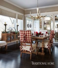 Cheerful red plaid on dining chair covers brings the holidays into the breakfast room. - Photo: Werner Straube / Design: Diane Young