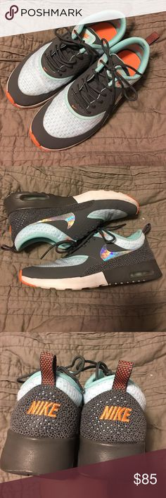 NIKE Air Max Thea Aqua Gray Orange Athletic Tennis Super great shoes from NIKE! AirMax Thea in Charcoal Gray, Aqua Blue and small orange accents. Swoosh is reflective, which is amazing. Worn once and realized I bought the wrong size.  Size is Women's 7. Nike Shoes Athletic Shoes