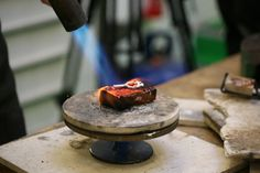 One of the jewellers in our London workshop working on Stephen's iconic Flame ring