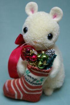 Sweet little Christmas mouse holding stocking