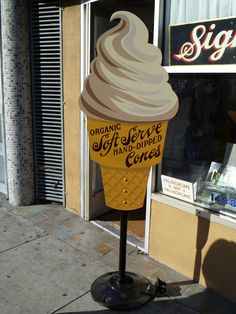 This week we made an ice cream cone sign, for Super Duper Burgers. They wanted one modeled on the cone we painted for the San Francisco Chocolate Store (which, I'm told, might actually be on… Ice Cream Logo, Ice Cream Man, Ice Cream Parlor, Paleterias Ideas, Cafe Design, Store Design, Gelato Shop, Soft Serve, Hand Painted Signs