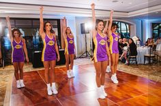 Hiring a local sports team cheer squad or marching band to perform for guests. Los Angeles Lakers girls at a wedding