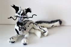 Soft Art Doll - Black and White DragonWolf, legs are partially movable, he can sit, lay and stay.   Handsewn and handpainted.   One of its kind.