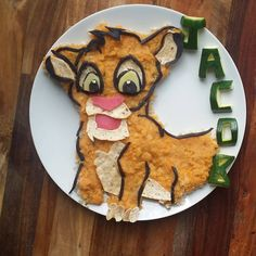 SIMBA from The Lion King Lentils with rice, whole meal wrap and zucchini letters #toddlerfoodideas #toddlermeals #toddler #foodart #foodforkids #funfood #simba #thelionking #disneyfood #disney #healthy #organicfood #organic #lentils #zucchini #rice #wholemealwrap #pumpkin #potatoes #carrots #jacobsfooddiaries