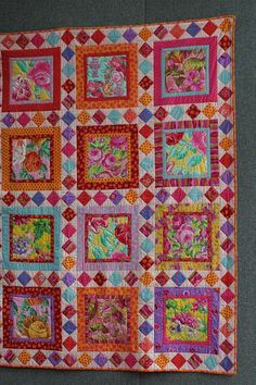 Kaffe Fasset - Mexican party quilt. I need a board just for his fabric. I love the bright colors so much.