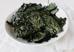 Kale Chips 4-6 servings Tear leafy parts from a head of kale into 2″-3″ pieces. Whisk 3 Tbsp. extra-virgin olive oil and 1 Tbsp. soy sauce in a large bowl; add kale and toss to coat. Spread out kale in an even layer on a baking sheet. Cover with another baking sheet and bake in a 300° oven until crisp, 12-15 minutes.