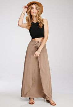 """F21 Contemporary - Walk around feeling graceful in this pretty maxi skirt! It features a stunning tulip front and a self-tie bow at the waist. Cut from a crinkled woven fabric, this piece can go casual with sandals or dressed up with wedges (you'll be wearing it all summer long).   * Concealed back zipper, unlined  * Lightweight, woven  * 100% rayon  * 41"""" full length, 28"""" waist  * Measured from Small  * Hand wash cold  * Imported   Model Info:Height: 5'8"""" 
