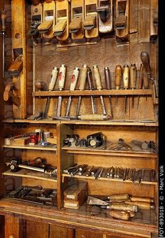Antique woodworkers cabinet with various tools.