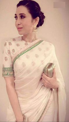 Karishma Kapoor in off white georgette saree with half sleeve designer blouse with green border on sleeve