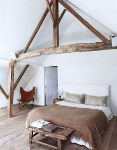 rustic bedroom with old (but modern) Butterfly chair