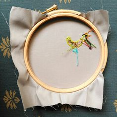 Tiny little hoop guts. Hand embroidery using bright colours.