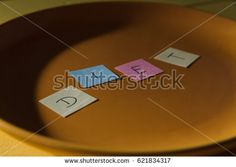 Conceptual image for dieting: plate with colour paper pieces spelling diet.