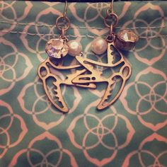 Sparrow shaped silver earrings Sparrow shaped silver sparrows with pearl and rhinestone. Great pre worn condition. BKE Jewelry Earrings