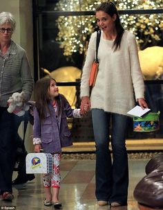 Unique style: Suri Cruise steps out for dinner in New York tonight with mother Katie Holmes and grandmother Kathleen