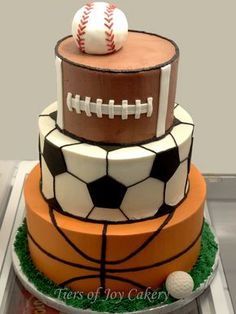 Sports balls cake with baseball, football, soccer ball, basketball and golf ball.