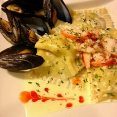 Homemade lobster & spinach ravioli with creamy butter garlic sauce.