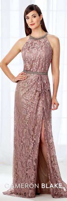 Cameron Blake 118678 - This swoon-worthy sleeveless allover metallic lace A-line gown features a beaded jewel halter neckline and beaded natural waist, and a side draped skirt accented with a side ruffle, a side slit, and a sweep train. A matching shawl is included.