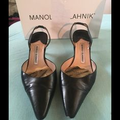 Sale! Auth Manolo Blahnik Carolyne Slingback 39 Good used condition authentic Manolo Blahnik Black Carolyne Slingback size 39.  There is some scuffing on the tip of the toes and a mark where a petal pusher was removed from the inner sole.  There is some wear on the heels.  Comes with duster bag and original box.  Box tape damaged from move. Manolo Blahnik Shoes