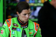 Danica Patrick, driver of the #10 GoDaddy Chevrolet, stands in the garage area during practice for the 57th Annual Daytona 500 at Daytona International Speedway on February 14, 2015 in Daytona Beach, Florida.