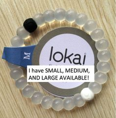 LOKAI BRACELET! WITH MUD FROM THE DEAD SEA AND WATER FROM MOUNT EVEREST, BEST PRICE OUT THERE $14.99!