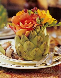 Skip the pumpkin vase, and arrange your fall flowers in a hollowed-out artichoke.