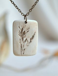 Pride  a sweet porcelain pendant with impression by peifferStudios.  How do I make this?  Love it!!!