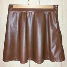 """~NWT~ Faux Leather Brown Skater Skirt New with tag ~ never worn. Skirt is lined and faux leather has a slight bit of stretch.Measured laid flat-  ~waste 13.5"""" ~length 15.5"""" From ~smoke free~ home 36point5 Skirts Mini"""