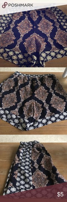 Paisley patterned shorts high waisted Blue copper and white Paisley patterned shorts.  High waisted with two invisible side pockets.  Flowy and great for petite sizes Shorts Jean Shorts