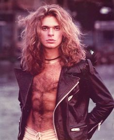 SUPER FRICKING HOT!!!Sporting a leather biker jacket, Van Halen's David Lee Roth shows off his gorgeous mane of hair in this 1980s photo.