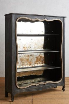 Persica Bookshelf- this piece is seriously cool! Love the mirror back and scroll detail.