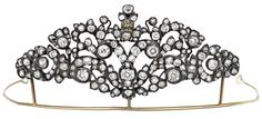 DIAMOND TIARA, LATE 18TH CENTURY. Of scroll and foliate design highlighted with cushion and circular-cut diamonds, mounted in silver and gold, inner circumference approximately 110mm.