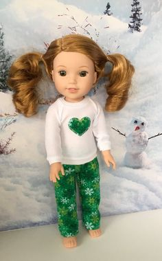 Green snowflake print pajamas and appliqued top for 14.5 inch dolls by MySewYouCreations on Etsy. Made from the Piccadilly Pjs for WellieWishers Dolls pattern, found at http://www.pixiefaire.com/products/piccadilly-pjs-for-welliewishers-dolls. #pixiefaire #piccadillypjsforwelliewishersdolls