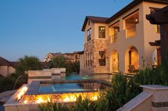 This award-winning pool features a glass tile spa with multiple spillways, sconces, and raised pedestals with lighted laminar jets. Millenium Pools, Austin, Texas. Designed by Joel Hefner, water shape designer.  Photography by Blake French http://www.luxurypools.com/builders-designers/millennium-pools.aspx?edgpid=1539=15211#!prettyPhoto_M15211/id1539/