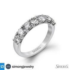 "A dazzling row of 1.50 ctw white #diamonds is just the right way to say ""Happy #Anniversary."" Featured style: MR2070  #SimonG #wedding #ring #arthursjewelers #twincities #Mpls #Diamond #event"