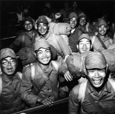 Exuberant Imperial Japanese soldiers returning home following the demobilization and repatriation of Japanese forces who had served overseas. Shinagawa Station, Tokyo. June, 1946.