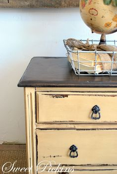 Ivoire by Sherwin Williams a light buttery yellow, then distressed and glazed with a dark brown stain.  Gorgeous