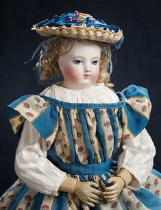 Theriault's Antique Doll Auctions - Adelaide Huret,circa 1860.