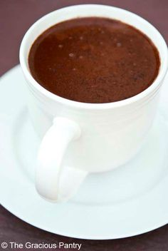 Clean Eating Coconut Hot Chocolate. A decadent, rich experience in a cup. Drink it hot or chill it for pudding! From TheGraciousPantry.com.