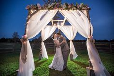 Nighttime, Twilight Bride and Groom Outdoor Wedding Portrait under Wedding Altar   Plant City Wedding Venue Wishing Well Barn   Tampa Wedding Photographer Rad Red Creative