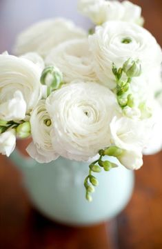 ranunculus bouquet with Fresia.. A touch of green & later the scent. Adorable in a teapot