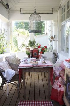i want a birdcage for a light fixture! and i love the bench built in (i think) below the window. i have a window exactly like that and it's difficult to arrange outdoor furniture in front of, the bench is the perfect solution